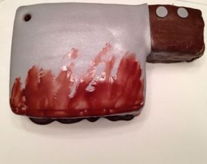 Yes, this is a bloody cleaver cake. Yes, it's quite graphic. But still, you have to give the baker credit for this.