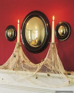 Actually these consist of cheese cloths and plastic spiders on the candlesticks. They also have old leaves for a more decrepit look.
