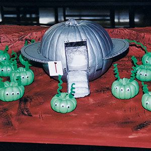 Now this is clever. This used a pumpkin as a flying saucer or UFO and small green pumpkins as aliens.