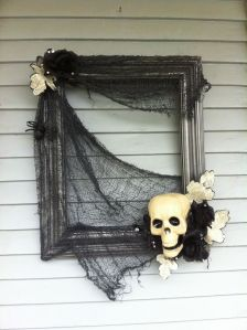 Now this is supposed to resemble cobwebs and skulls with feathers and bones. Yes, it's creative use with picture frames at its finest.