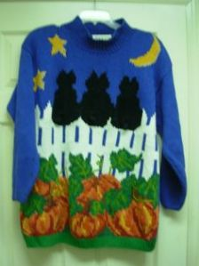 Does it mean bad luck or just 3 cats sitting on a fence. Either way, looks like the kind of Halloween sweater you'd see on a crazy cat person.