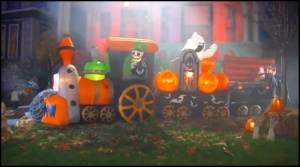 Funny how this train doesn't have any passenger cars. Still, love the ghost and pumpkins. Also, like the vampire rising from his coffin in the back.
