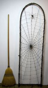 Of course, I can bet that this web was made by a tone of black yarn. Still quite cool though. However, I doubt that a spider would spin a web that big.