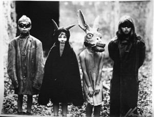 Strange that the least scary kid in this is the one with devil horns. The girl in the donkey head is particularly terrifying to say the least. The ones in masks aren't much better.