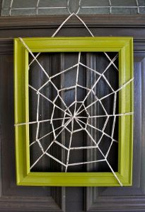 Now this looks quite simple to make. Just get some string and a picture frame. Then again, it might be a not at easy to make a spider web as it seems.