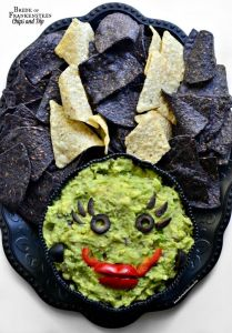 Now the dip is her face and consists of mostly guacamole. And her hair is mostly made from blue and regular tortilla chips. Still, very clever.