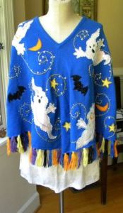 And it seems this one is in bright blue and decked with ghosts and bats. Seems that the ghosts are trying to be quite scary. Not sure if they are. Probably not.