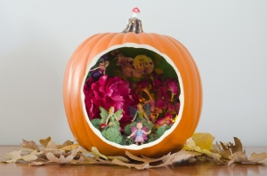 Yes, it's a fairy scene in a pumpkin. I know that pumpkins are fall plants while flowers are spring. Yes, it's kind of confusing.