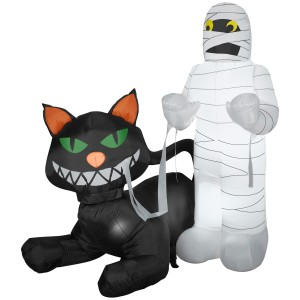 Yeah, the mummy isn't too happy while the cat is grinning. Hope he has enough strength to get out of this jam without losing a limb or unraveling.