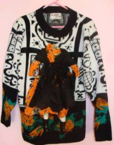 For some reason, I thought this was a sweater depicting a burning windmill. And I wondered why the hell would anyone want a Halloween sweater of that? The headless witch idea makes more sense.