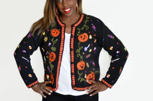 Of course, this is a colorful cardigan with the candy and all. However, I'm not sure about the pumpkins.