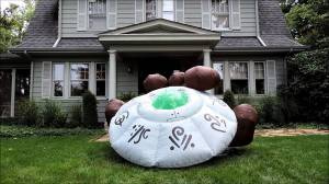 An inflatable flying saucer with inflatable dirt surrounding it. Yeah, that looks very realistic (sarcasm). The one in my lawn ornament post looked more believable.