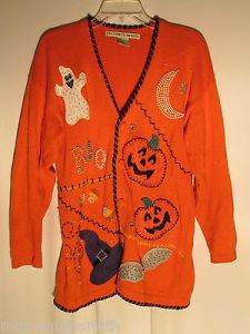 Looks like something a kindergarten teacher would wear. Still, why does the ghost have spots? Oh, i'ts to make it sparkle. Right.