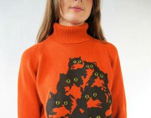 When looking at this sweater do you get the feeling that you're being watched? Or is it just me? Do those eyes seem creepy to you?
