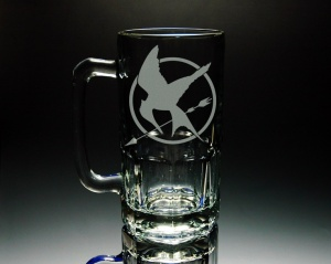 I can totally imagine Haymitch drinking from this. However, I don't think he'd be drinking beer or just beer in that though.
