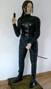 Now this is a 10 ft high cake of Katniss. It's not something I'd recommend anyone to make. But since it's associated with the Hunger Games, it's going in.