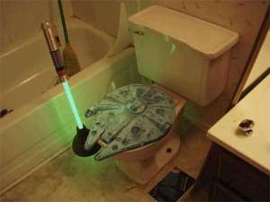 Now at least the Millennium Falcon toilet seat is better than Han Solo in carbonite. However, I'm not sure about the lightsaber plunger. That's just hard to take seriously.