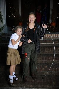 I'm sure Katniss's parents didn't buy most of her costume, especially the bow and ripped up pants. Still, that's an adorable picture.