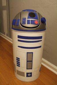 Because why buy an R2-D2 trash bin when you can make your own. It's much cheaper and only requires a plastic trash bin, printouts, a bottle cap, and felt.