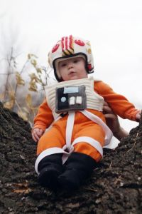 Now this is so adorable. Wonder if he has a little X-Wing stroller.