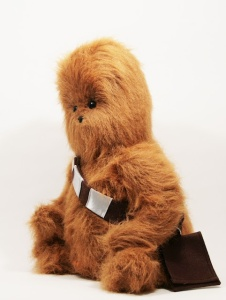 I think this was inspired by Wookiee the Chew which is a mashup of Star Wars and Winnie the Pooh. Still, this is adorable but he'd rip your arm out of your socket if he loses a chess game.