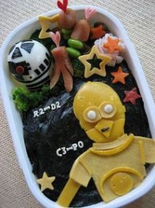 Now this has C-3PO in peppers while R2-D2 is a hardboiled egg. Still, it's really a work in food art if I say so myself.
