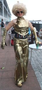 Yeah, a C-3PO polyester costume isn't very flattering. This is especialyl true with a blond afro and big gold sunglasses.
