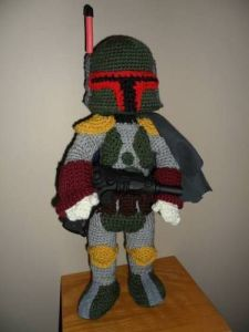 Yes, the most badass bounty hunter in the galaxy is a crocheted stuffed toy with at plastic gun and a nerf antenna. But still, he's out for that scruffy headed nerfherder.