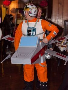 Now this is a clever homemade costume. Love how the X-Wing was made from cardboard boxes.