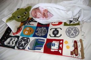 As you see here, this is a perfect gender neutral baby gift. And Yoda's even on the pillow.