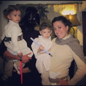 Still, that is no way to hold a lightsaber. But I wonder if the mom is supposed to be Padme or Leia in another outfit.