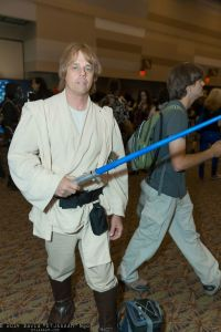 Almost does look like an older Mark Hamil. However, I'm sure it's not him, since he has a toy lightsaber in his hand.
