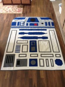 Now this is a way better rug than the Chewbacca skin one which is disturbing. But this R2-D2 one is adorable.