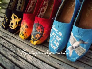 Each has the Mockingjay logo on one shoe and a quote on the other. And all are in the same color as the book covers.