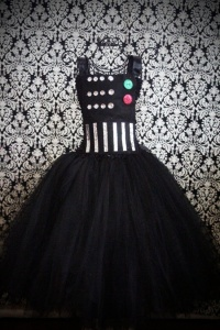 Now this has some buttons and shimmering pieces. And with a long skirt, too. Vader would be proud.