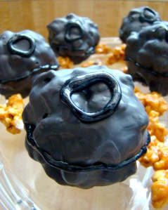 Yes, these are Death Star popcorn balls with black icing on them. And yes, they might get stuff stuck in your teeth for awhile.