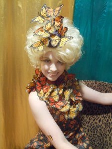 Now that's a butterfly dress I'm talking about. Well, at least in Effie Trinket's case. Chances are it took a long time to make this costume.