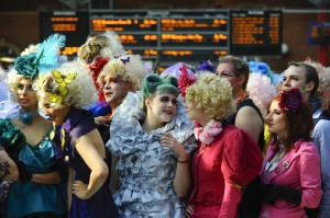 "Caption: ""Members of the public turn up at London's Marylebone Station dressed as Effie Trinket as part of 'The Hunger Games: Catching Fire' Capitol Costume Competition in which the winner gets to attend the 'Mokingjay: Part 1' premiere."""