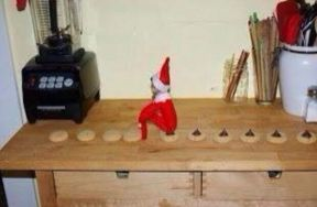 elf-on-the-shelf-pooping-chocolate-onto-cookies-article