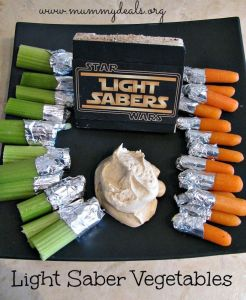 All you need is to cover one tip of celery and carrots with aluminum foil and you're all set. Talk about having sword fights on a veggie tray.