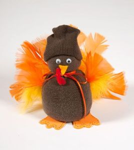 Now this turkey seems to have a dark tossel hat instead of a Pilgrim hat. Does that mean this turkey is a thug? Not sure.