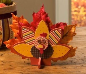Now this is just adorable. Love the wooden and the autumn leaf feathers on this one.
