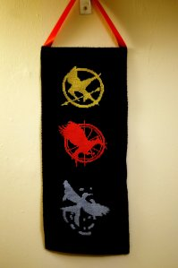 Consist of the Mockingjay logos you see on all 3 novels and in the same colors. Should go well with a lot of Hunger Games crafts.