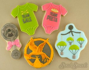What the fuck? For God's sake why have a Hunger Games themed baby shower? That's as bad as having the Lorax as a spokesman for Hummer.