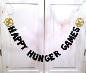 "Uh, to me the notion, ""Happy Hunger Games"" is pretty disturbing. Kind of suggests that the Hunger Games are a more festive event instead of the horrible sick show they are."