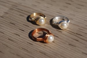 Available in gold, silver, and bronze. Still, if you don't know the significance of the pearl, then read the books.