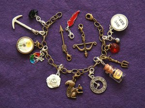 Seems to have a lot of charms that you'd associate with the Hunger Games. Wonder if you can fit them all.