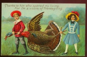 Okay, those kids are clearly carrying a dead turkey. Seriously, how do I explain such images to young children?
