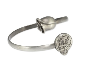 "From Entertainment Weekly: ""Forget Team Peeta and Team Gale, it's all about Team Snow. Why not show your support for the misunderstood fascist dictator with this rose and Capitol seal bracelet? It is pretty, but isn't the thought of wearing the emblem of an evil ruler (who doesn't even have cool magical powers) a little disturbing?"""