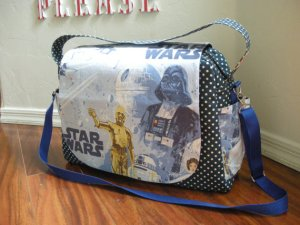 Though I know it's a Star Wars diaper bag, I find Darth Vader's image on here ironic. Let's just say his approach to parenting falls squarely on the Dark Side since he cut off his son's hand and blew up his daughter's planet.